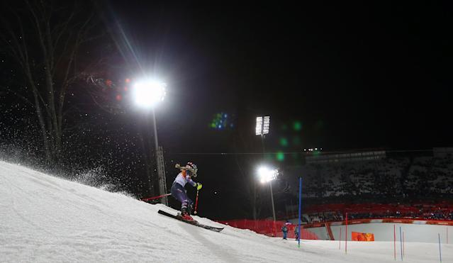 Gold medal winner Mikaela Shiffrin skis past a gate in the women's slalom at the Sochi 2014 Winter Olympics, Friday, Feb. 21, 2014, in Krasnaya Polyana, Russia. (AP Photo/Alessandro Trovati)