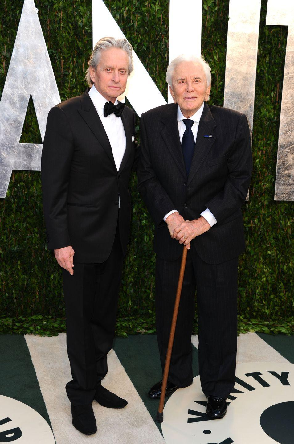 <p>Kirk arrives with his son Michael at the 2012 Vanity Fair Oscar party. </p>