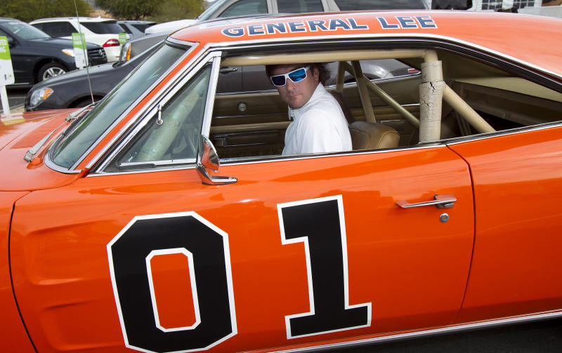 """Golfer Bubba Watson drives off in the General Lee after playing in pro-am at the Phoenix Open golf tournament at the TPC Scottsdale Stadium Course in Scottsdale, Ariz., Wednesday, Feb. 1, 2012.  Watson bought the General Lee used in """"The Dukes of Hazzard"""" TV series pilot episode, for $110,000 at the famed Barrett-Jackson automobile auction recently. (AP Photo/The Arizona Republic, Rob Schumacher) MARICOPA COUNTY OUT; MAGS OUT; NO SALES"""
