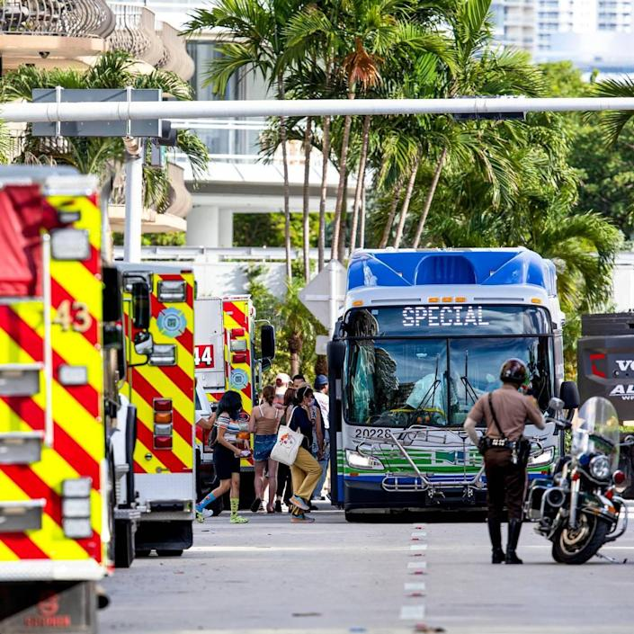 Family and friends load onto a Miami-Dade Metro Bus to be taken back to the 'reunification center' after visiting the site of the partially collapsed Champlain Towers South Condo on the fourth day in the Surfside community of Miami Beach, Florida, on Sunday, June 27, 2021. The 12-story oceanfront condo tower at 8777 Collins Ave. crumpled just after 1:30 a.m., on Thursday June 24, trapping an unknown number of residents asleep in their beds inside the wreckage.
