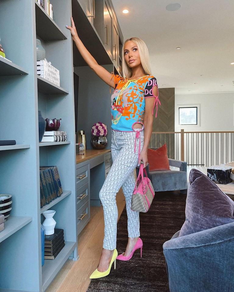 """<p>The <em>Real Housewives of Beverly Hills</em> star struck a pose beside her <a href=""""https://www.instagram.com/p/CGfwo6xnOt2/"""">upstairs built-ins</a> before a """"Girls day 💛🌸💎.""""</p>"""