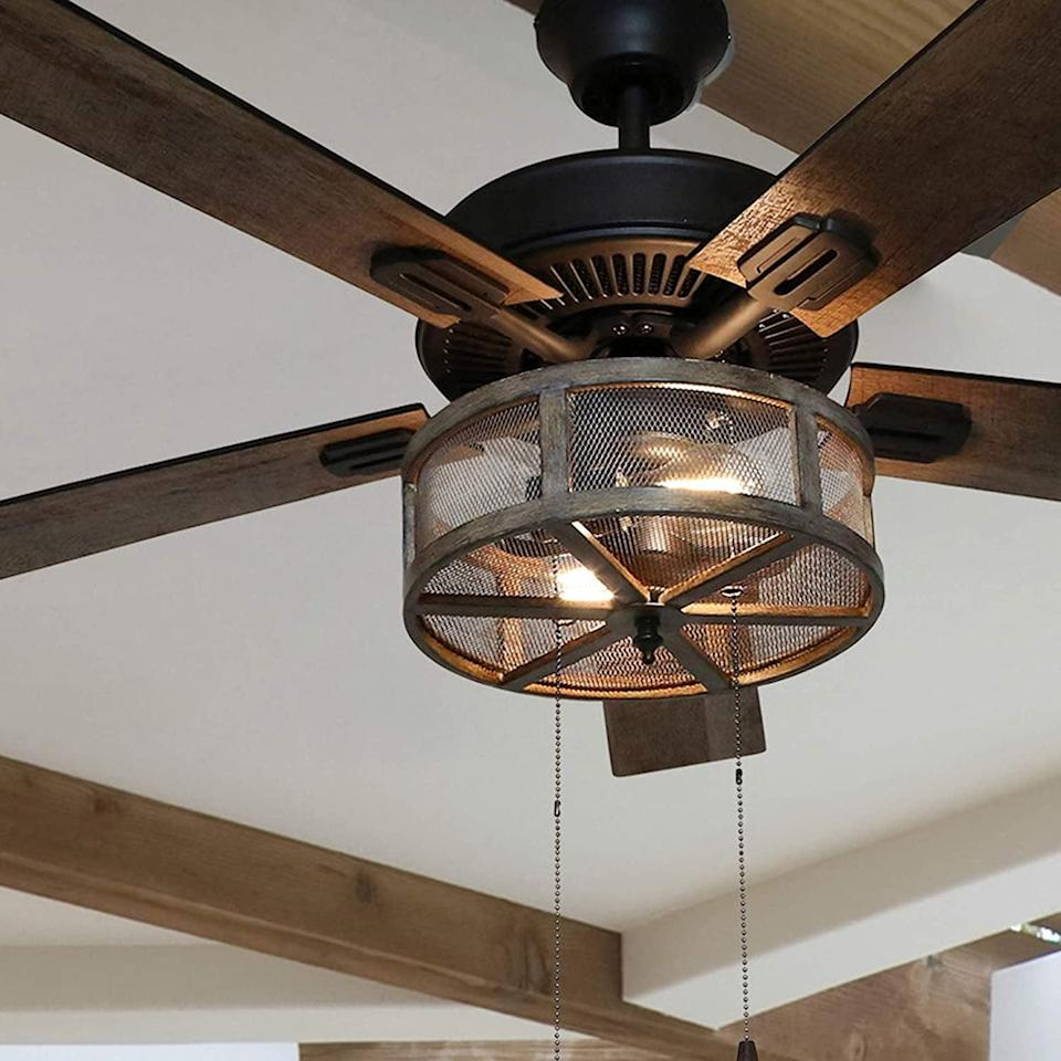 <p>Revamp your space with this <span>River of Goods 52 Inch Width Farmhouse LED Ceiling Fan</span> ($190). The farmhouse-style fan has a unique industrial touch that will make your space feel cozy.</p>