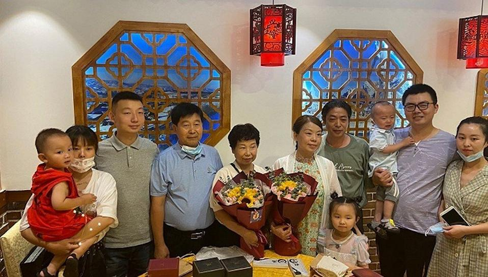 Yao (third left) and Guo (second right) celebrate their birthday in Shanghai in June 2020 with their families, including Yao's birth mother Du Liqing (fifth left) and Guo's birth mother Xu (sixth left). Photo: Jiemian.com