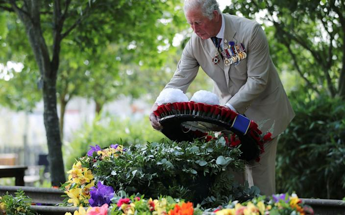 The Prince of Wales lays a wreath during the national service of remembrance - PA