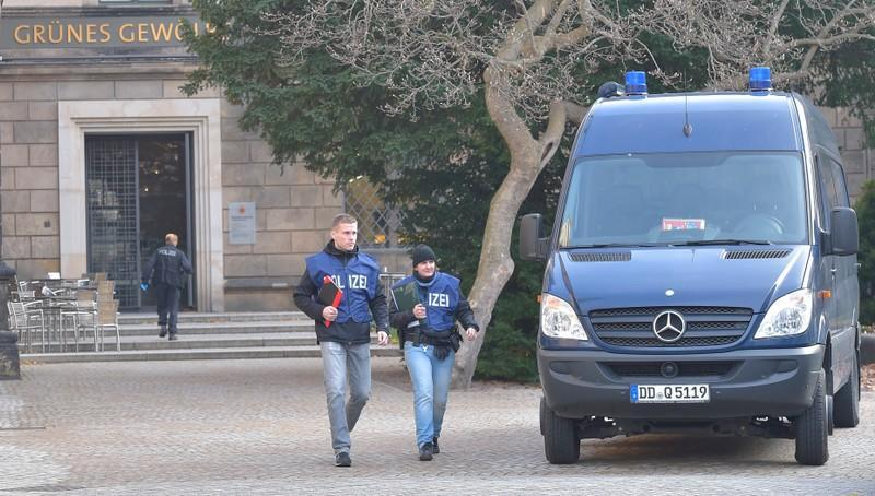 Police offciers leave Green Vault city palace after a robery in Dresden