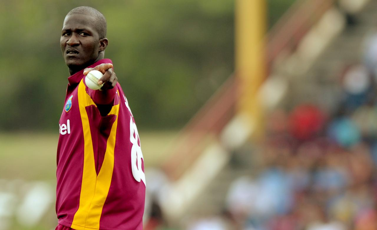 West Indies cricketer Darren Sammy gestures before bowling during the fifth-of-five One Day International (ODI) matches between West Indies and Australia at the Beausejour Cricket Ground in Gros Islet, St. Lucia on March 25, 2012.     AFP PHOTO/Jim Watson (Photo credit should read JIM WATSON/AFP/Getty Images)