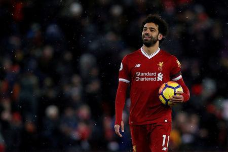 Soccer Football - Premier League - Liverpool vs Watford - Anfield, Liverpool, Britain - March 17, 2018 Liverpool's Mohamed Salah celebrates with the match ball after the match Action Images via Reuters/Lee Smith
