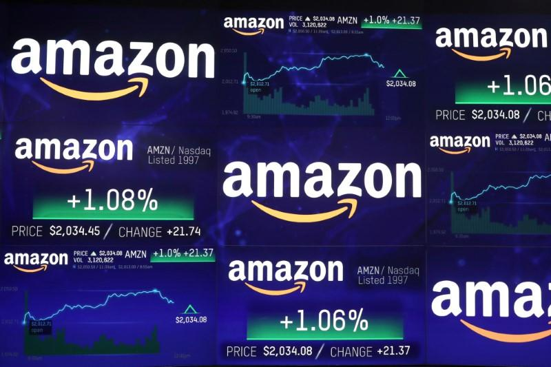 FILE PHOTO: The Amazon.com logo and stock price information is seen on screens at the Nasdaq Market Site in New York City