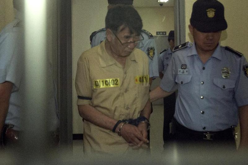 Sewol ferry captain Lee Joon-Seok (centre) during a previous appearance at the Gwangju District Court in South Korea, on June 24, 2014