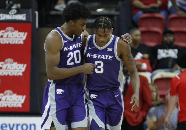 Kansas State's Xavier Sneed, left, embraces Dajuan Gordon after defeating UNLV in overtime of an NCAA college basketball game Saturday, Nov. 9, 2019, in Las Vegas. (AP Photo/John Locher)