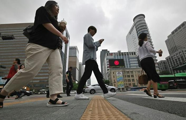 A new South Korean law will criminalise business owners who unfairly dismiss employees harassed at work (AFP Photo/Jung Yeon-je)