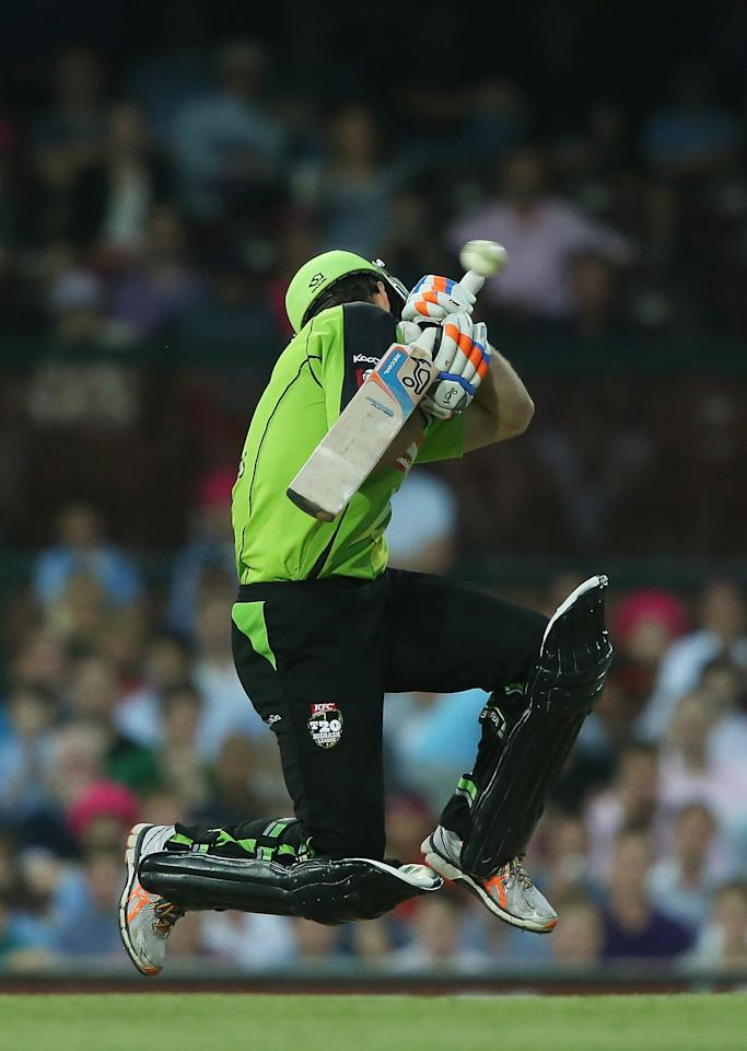 SYDNEY, AUSTRALIA - DECEMBER 08: Ryan Carters of the Thunder attempts to evade a delivery from Mitchell Starc of the Sixers during the Big Bash League match between the Sydney Sixers and the Sydney Thunder at Sydney Cricket Ground on December 8, 2012 in Sydney, Australia.  (Photo by Mark Metcalfe/Getty Images)