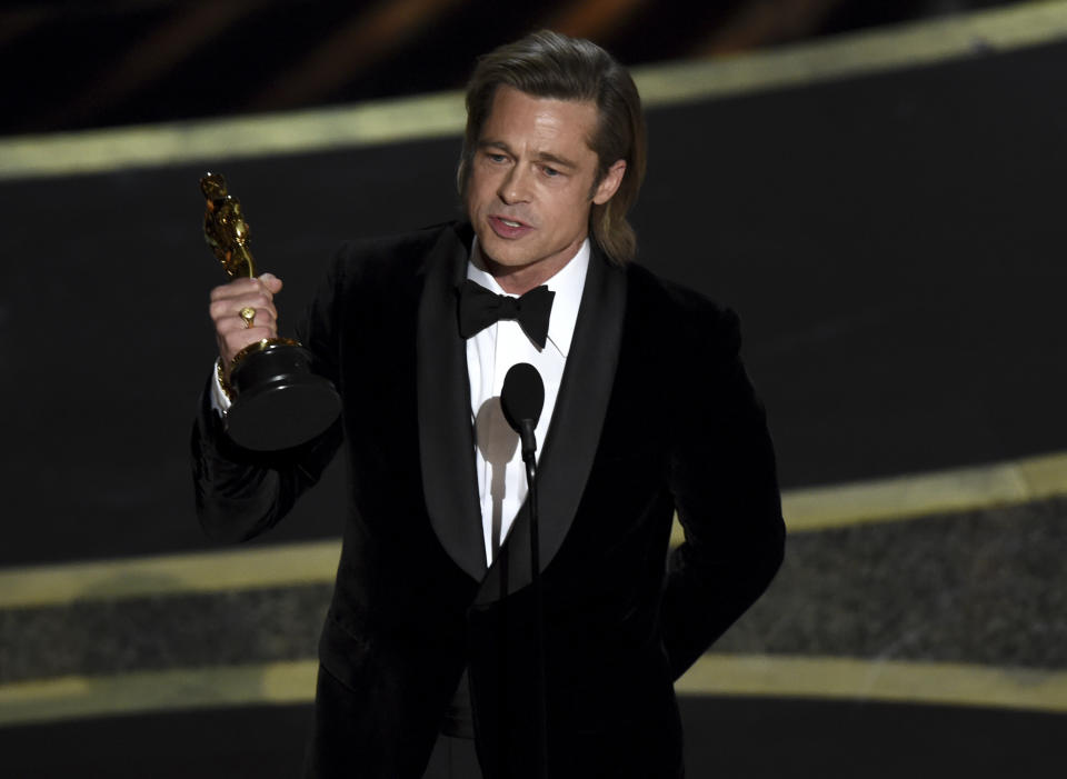 "Brad Pitt accepts the award for best performance by an actor in a supporting role for ""Once Upon a Time in Hollywood"" at the Oscars on Sunday, Feb. 9, 2020. (AP Photo/Chris Pizzello)"