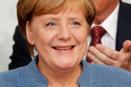 Christian Democratic Union (CDU) party leader and German Chancellor Angela Merkel reacts on first exit polls in the German general election (Bundestagswahl) in Berlin, Germany, September 24, 2017. REUTERS/Fabrizio Bensch