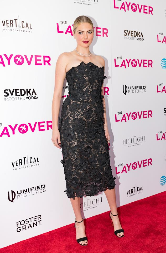 <p>The model-turned-actress gave a dramatic turn on the red carpet in a lacy black J. Mendel dress.<br /><i>[Photo: Getty]</i> </p>