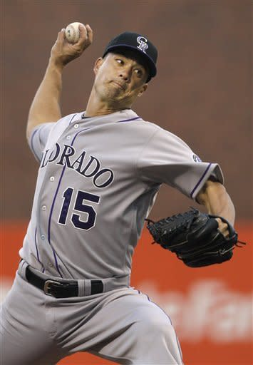 Colorado Rockies' Jeremy Guthrie pitches to the San Francisco Giants during the second inning of a baseball game in San Francisco, Tuesday, May 15, 2012. (AP Photo/Jeff Chiu)