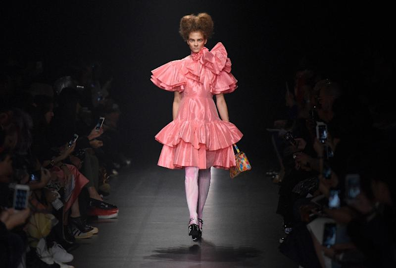 A model showcases a creation from 'Dresscamp' by Japanese designer Tosihikazu Iwaya, during the 2016 Spring/Summer Tokyo Fashion Week (AFP Photo/Toru Yamanaka)