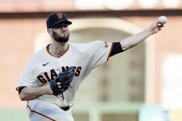 San Francisco Giants starting pitcher Alex Wood throws against the Texas Rangers during the first inning of a baseball game in San Francisco, Monday, May 10, 2021. (AP Photo/John Hefti)