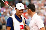 Thanks partner: Rory McIlroy (right) celebrates with Harry Diamond after the caddie's crucial intervention on the final hole enabled the Northern Irishman to break his long win drought at the Wells Fargo Championship at Quail Hollow on Sunday