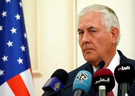U.S. Secretary of State Rex Tillerson listens to a reporter's question alongside Qatar's Foreign Minister Sheikh Mohammed bin Abdulrahman Al Thani during a media availability after their meeting, in Doha
