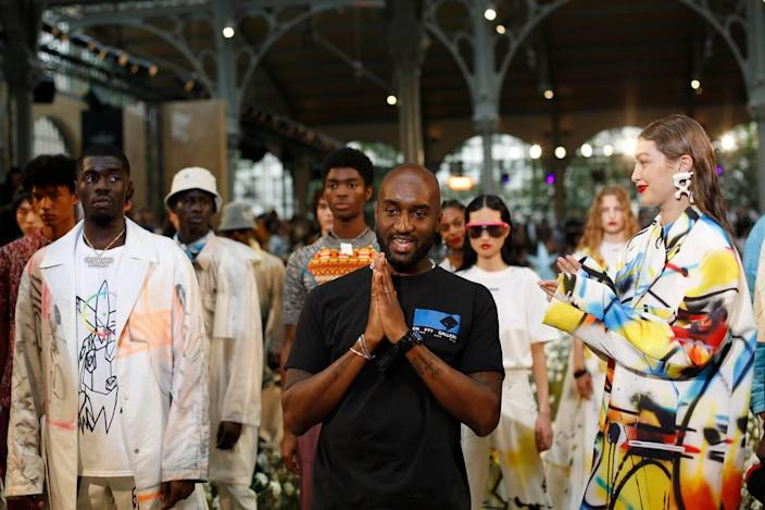 Designer Virgil Abloh, centre, accepts applause as he poses with other models including Gigi Hadid, right, at the conclusion of the Off White mens Spring-Summer 2020 fashion collection presented in Paris, Wednesday, June 19.