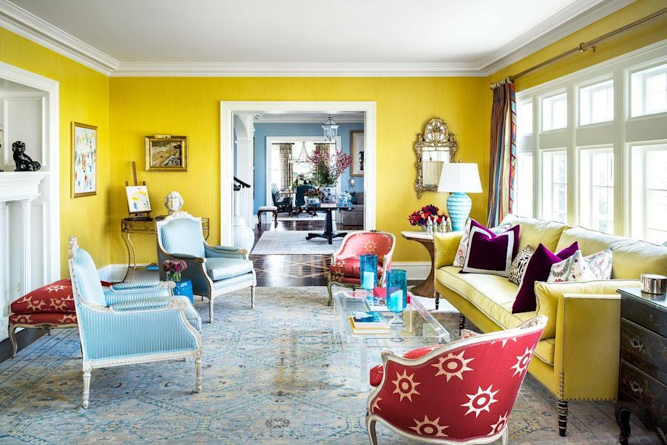 """<p>Does the thought of painting your living room yellow scare you to your very core? How about now that you've seen this timeless and cheerful living room designed by <a href=""""https://www.michaelmaherdesign.com/"""" rel=""""nofollow noopener"""" target=""""_blank"""" data-ylk=""""slk:Michael Maher"""" class=""""link rapid-noclick-resp"""">Michael Maher</a>? One glance at this space, and we're about ready to repaint our own: It radiates warmth and offsets the cool blue tones. </p>"""
