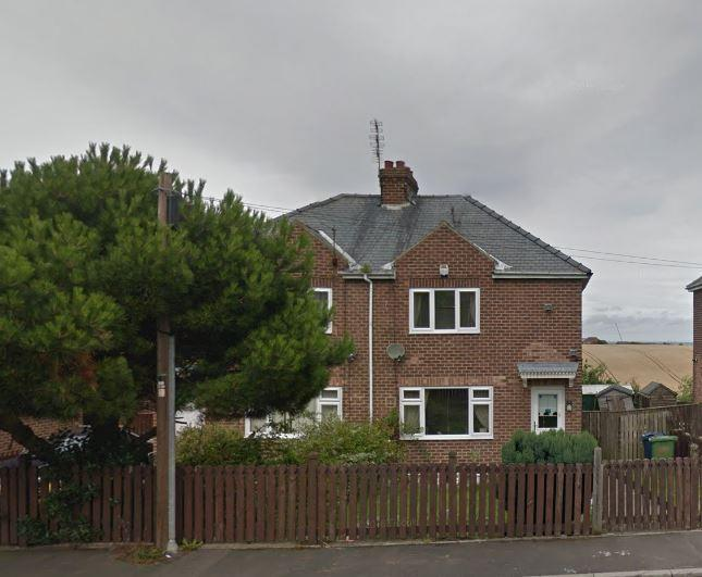 The house on the right as it used to look. It's (mostly) still standing (Google Street View)