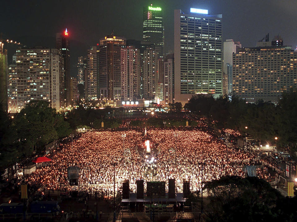 FILE - In this June 4, 1999, file photo, thousands of people attend a candlelight vigil in Hong Kong's Victoria Park to mark the 10th anniversary of the military crackdown on a pro-democracy student movement in Beijing. (AP Photo/Vincent Yu, File)