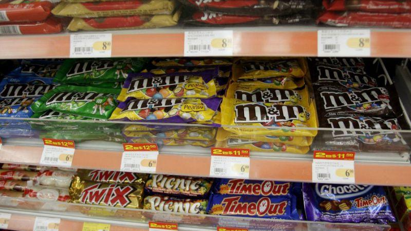 Chocolate bars are seen on a store shelf. (Quartz)