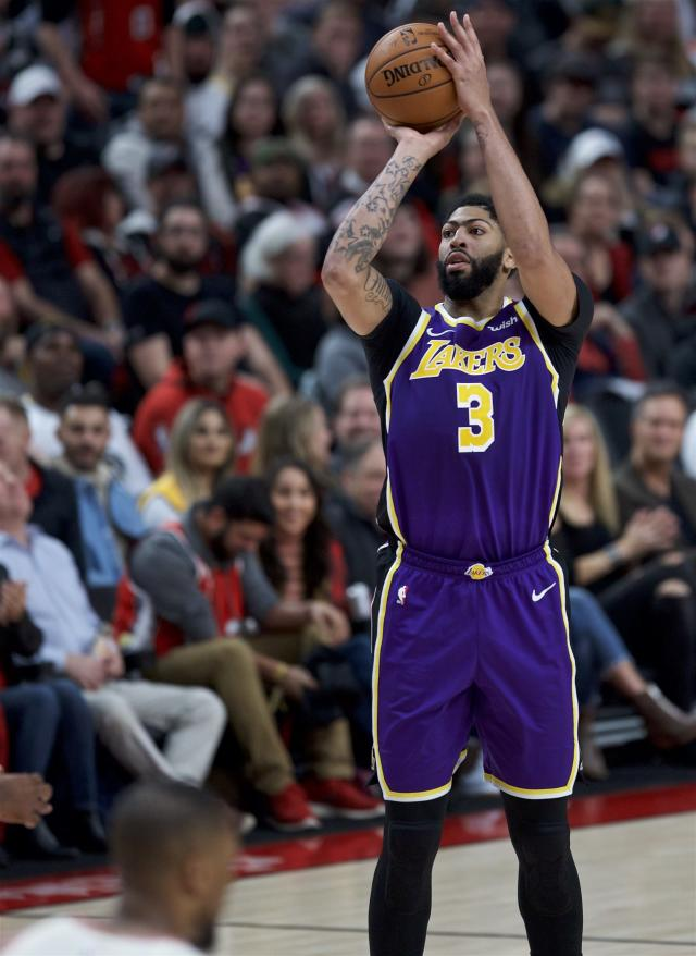 Los Angeles Lakers forward Anthony Davis shoots against the Portland Trail Blazers during the first half of an NBA basketball game in Portland, Ore., Saturday, Dec. 28, 2019. (AP Photo/Craig Mitchelldyer)