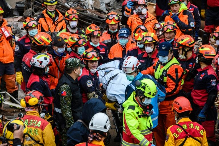Rescue workers brought out the body of a hotel worker on Thursday afternoon