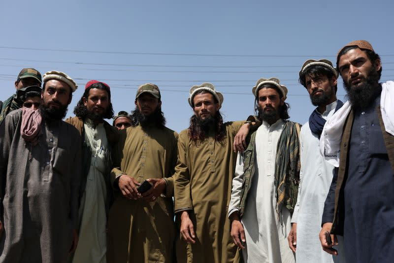 Taliban members pose for a photograph in Kabul