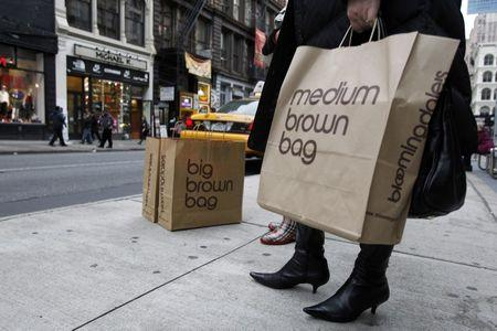 A shopper holds her bags as she tries to hail a cab in New York