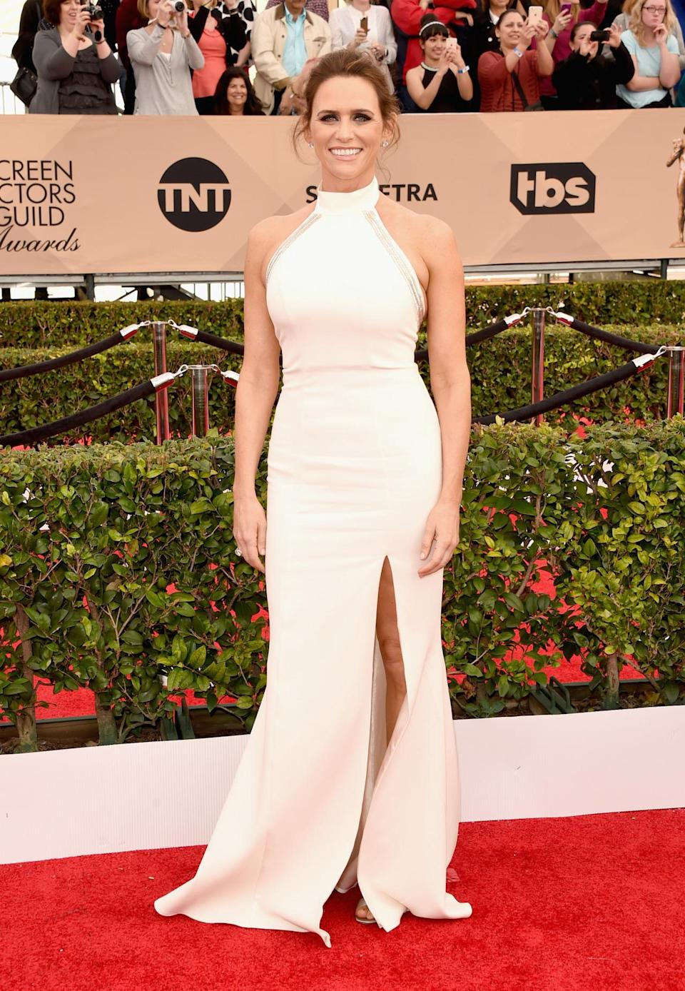 <p>The <i>Transparent </i>actress brought the street style turtleneck trend to the red carpet in a white gown with a center slit in the skirt. </p>
