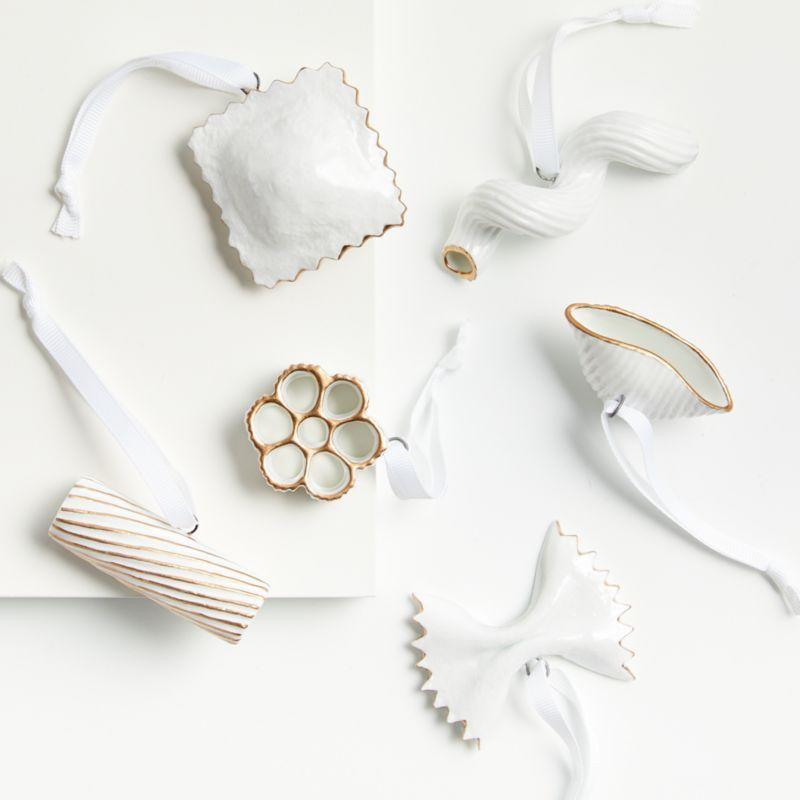 """<p><strong>crate and barrel</strong></p><p>crateandbarrel.com</p><p><strong>$29.95</strong></p><p><a href=""""https://go.redirectingat.com?id=74968X1596630&url=https%3A%2F%2Fwww.crateandbarrel.com%2Fpapa-leos-pasta-ornaments-set-of-6%2Fs638874&sref=https%3A%2F%2Fwww.countryliving.com%2Fshopping%2Fgifts%2Fg34058558%2Fsupport-feeding-america%2F"""" rel=""""nofollow noopener"""" target=""""_blank"""" data-ylk=""""slk:Shop Now"""" class=""""link rapid-noclick-resp"""">Shop Now</a></p><p>Crate & Barrel is debuting a porcelain set of Papa Leo's Pasta Ornaments for holidays. The set was inspired by a staffer's father who has worked in Italian restaurants for many decades, and for each set sold, $10 will be donated to Feeding America. From November 1 to December 31, <a href=""""https://www.crateandbarrel.com/feedingamerica"""" rel=""""nofollow noopener"""" target=""""_blank"""" data-ylk=""""slk:Crate & Barrel"""" class=""""link rapid-noclick-resp"""">Crate & Barrel</a> customers can also donate to Feeding America in-store and online, and 100 percent of funds raised will benefit member food banks across the country. </p>"""