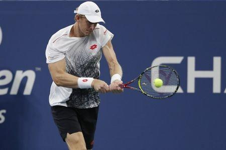 Isner ousts Raonic at U.S. Open