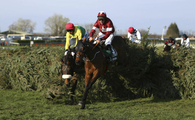 Tiger Roll ridden by jockey Davy Russell on the way to winning the Grand National Handicap Chase at the Grand National Horse Racing Festival at Aintree Racecourse, near Liverpool, England, Saturday April 6, 2019. (Nigel French/PA via AP)