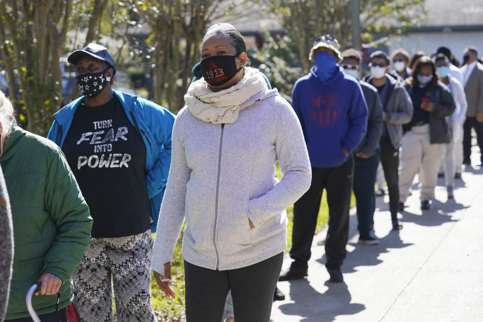 FILE - In this Nov. 3, 2020, file photo, voters standing in line at Precinct 36 as they wait to vote in the general election in Jackson, Miss. Months of discussions about racial justice are being followed by change at the ballot box. (AP Photo/Rogelio V. Solis, File)