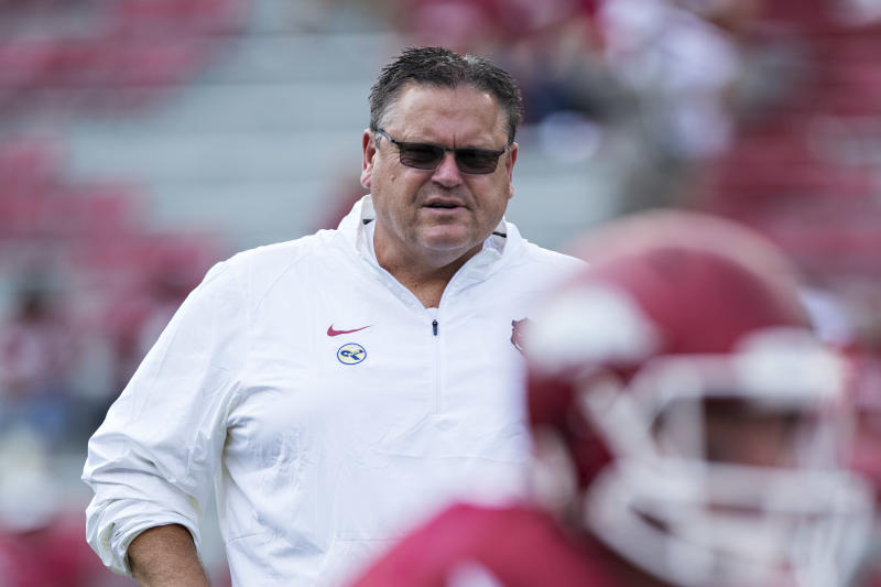 FAYETTEVILLE, AR - SEPTEMBER 5: Offensive line coach Sam Pittman of the Arkansas Razorbacks watches the team warm up before a game against the UTEP Miners at Razorback Stadium on September 5, 2015 in Fayetteville, Arkansas. The Razorbacks defeated the Miners 48-13. (Photo by Wesley Hitt/Getty Images)