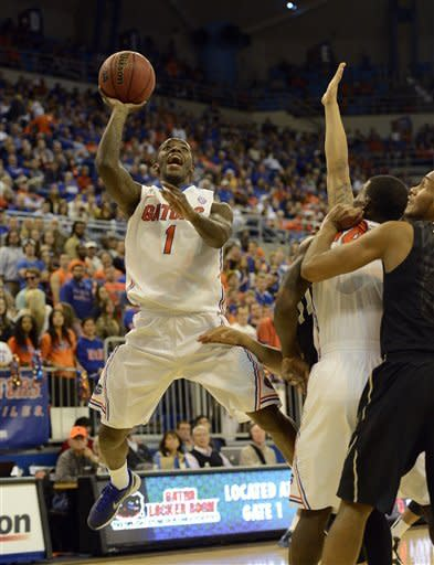 Florida guard Kenny Boynton (1) goes up for two points during the first half of an NCAA college basketball game against Vanderbilt in Gainesville, Fla., Wednesday, March 6, 2013. (AP Photo/Phil Sandlin)