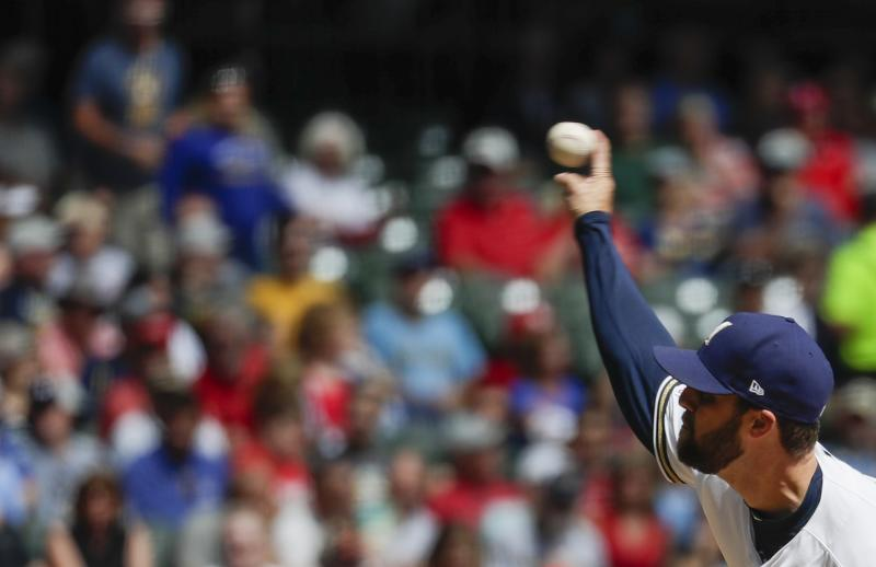 Milwaukee Brewers starting pitcher Jordan Lyles throws during the first inning of a baseball game against the St. Louis Cardinals Wednesday, Aug. 28, 2019, in Milwaukee. (AP Photo/Morry Gash)