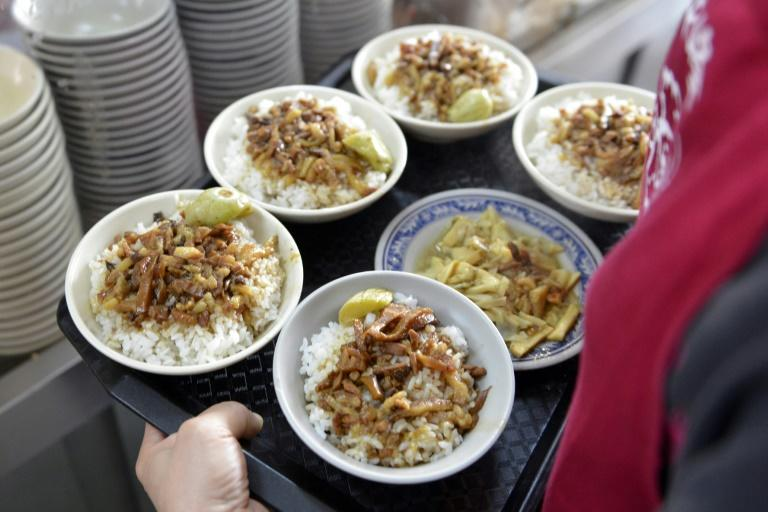 """Taiwanese foodies are speculating that Jinfeng -- a no-frills corner joint serving Tw$30 ($1) bowls of rice topped with braised minced fatty pork, called """"lu rou fan"""" -- could make the 2018 Michelin Taipei Guide."""