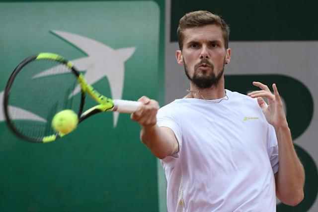Not quite cricket: Germany's Oscar Otte on his way to victory over Malek Jaziri (AFP Photo/Philippe LOPEZ)