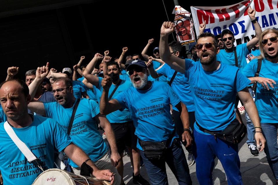 Workers of a fertiliser company shout slogans during a demonstration against a planned labour bill, during a 24-hour strike in Athens, Greece, June 10, 2021. REUTERS/Alkis Konstantinidis