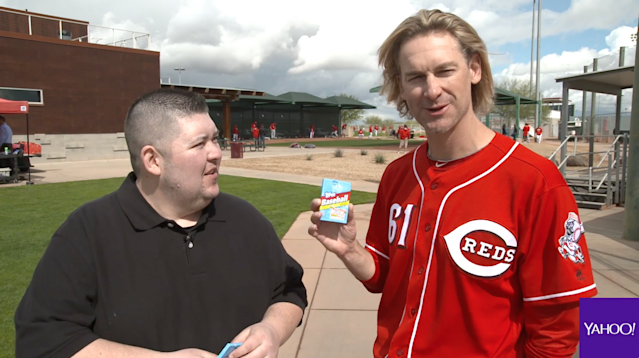 Bronson Arroyo opening 25-year-old baseball cards. (Yahoo Sports)