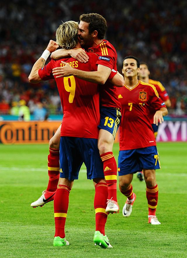 KIEV, UKRAINE - JULY 01: Juan Mata of Spain celebrates with team-mate Fernando Torres after scoring his team's fourth goal during the UEFA EURO 2012 final match between Spain and Italy at the Olympic Stadium on July 1, 2012 in Kiev, Ukraine. (Photo by Laurence Griffiths/Getty Images)