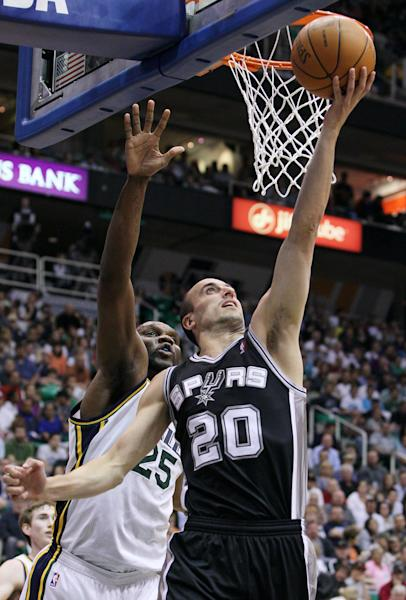 San Antonio Spurs guard Manu Ginobili (20), of Argentina, scores against Utah Jazz center Al Jefferson (25) during the first half of Game 3 in their first-round NBA basketball playoff series, Saturday, May 5, 2012, in Salt Lake City. (AP Photo/Colin E Braley)