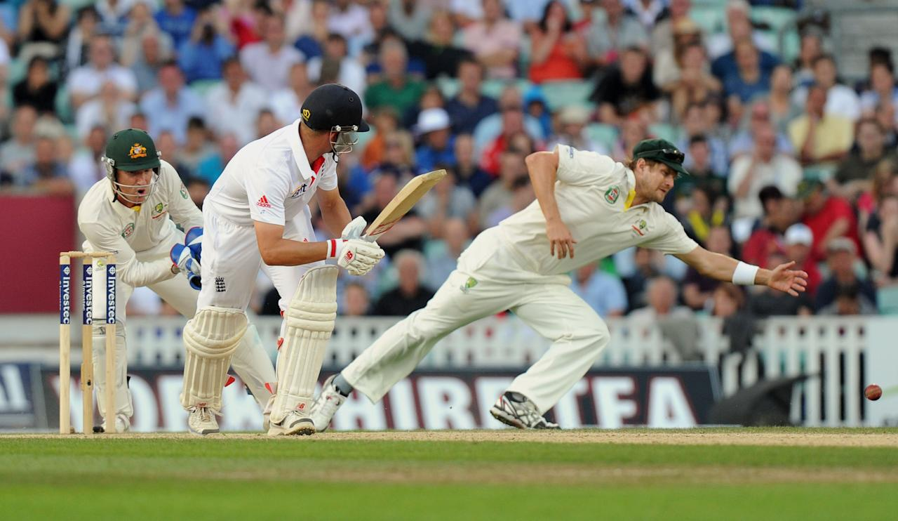 England's Jonathan Trott hits a shot past Australia's Shane Watson during day five of the Fifth Investec Ashes Test match at The Kia Oval, London.