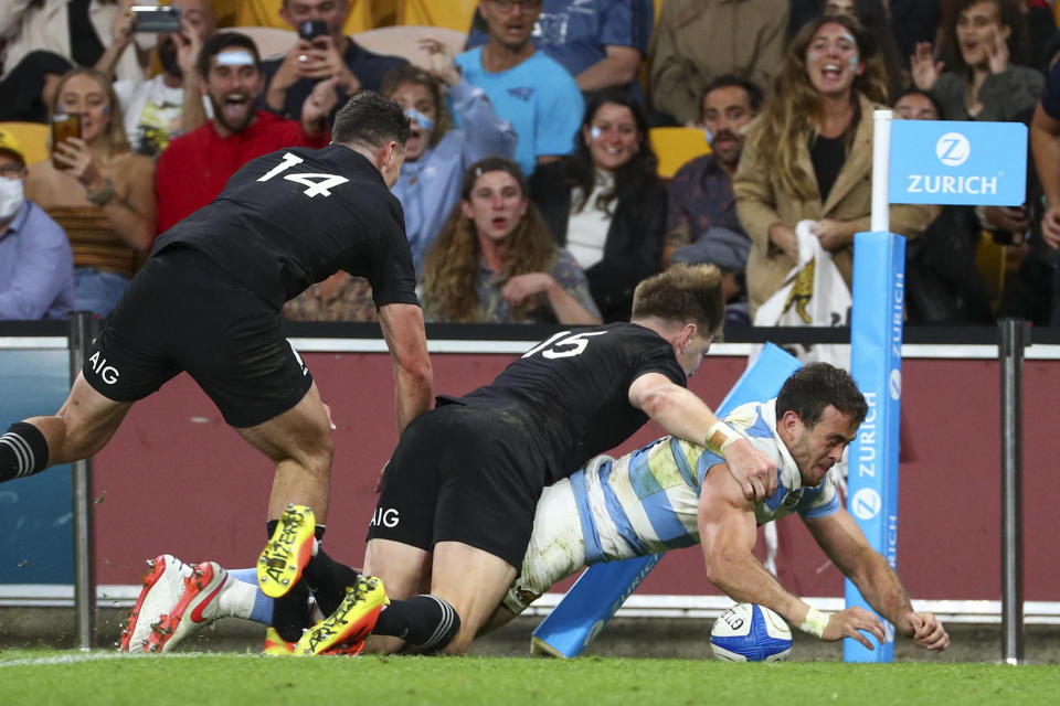 Argentina's Emiliano Boffelli scores a try during the Rugby Championship test match between the All Blacks and the Pumas in Brisbane, Australia, Saturday, Sept. 18, 2021. (AP Photo/Tertius Pickard)