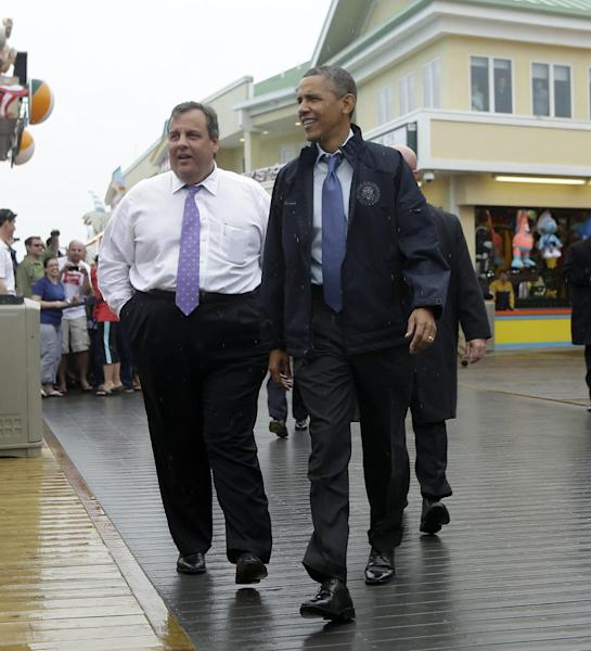 President Barack Obama and New Jersey Gov. Chris Christie walk along the boardwalk during their visit to Point Pleasant, NJ., Tuesday, May 28, 2013. Obama traveled to New Jersey to join Christie to inspect and tour the Jersey Shore's recovery efforts from Hurricane Sandy. (AP Photo/Pablo Martinez Monsivais)